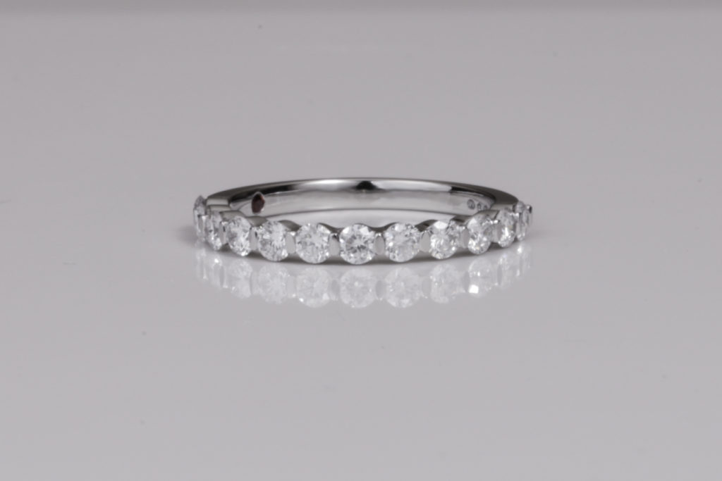 http://Half%20diamond%20eternity%20ring%20set%20with%20a%20garnet